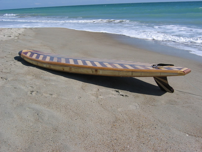 wooden hollow surfboard